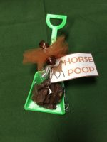 Horse Poop in green shovel